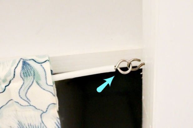 A hook and eye fastener for hanging a curtain to shelves for craft room organization.