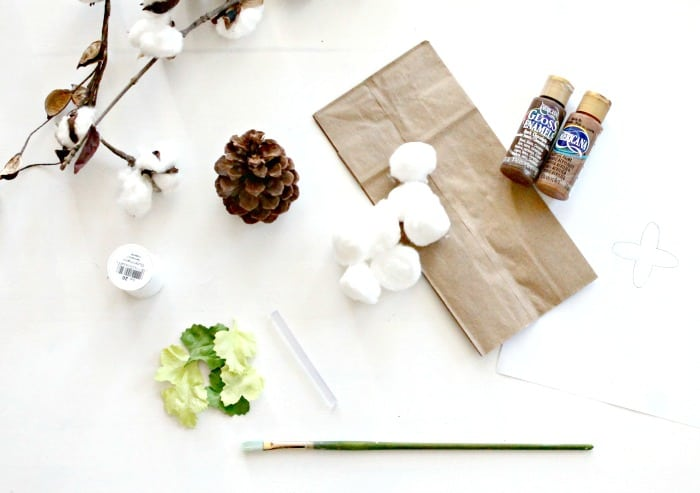 Photo of the supplies needed for handmade cotton stems, including pine cones, cotton balls and brown paper bags. DIY cotton branches, cotton pod, DIY cotton stems, DIY cotton balls DIY, art and craft, DIY crafts, cotton branches, cotton craft, cotton ball crafts,.