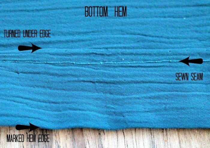 How to sew the bottom seam of a DIY curtain that adds a layer of colour to fall home decor.
