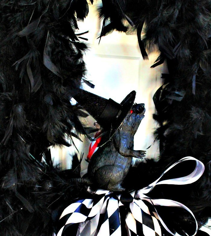 Centerpiece of black feathered wreath for Halloween.