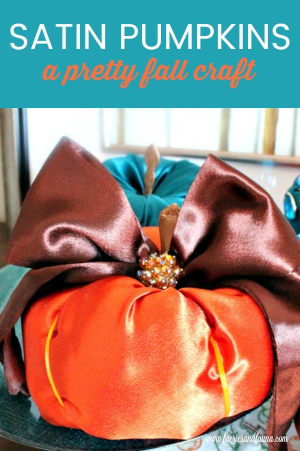 DIY fabric pumpkin in satin and orange and teal.