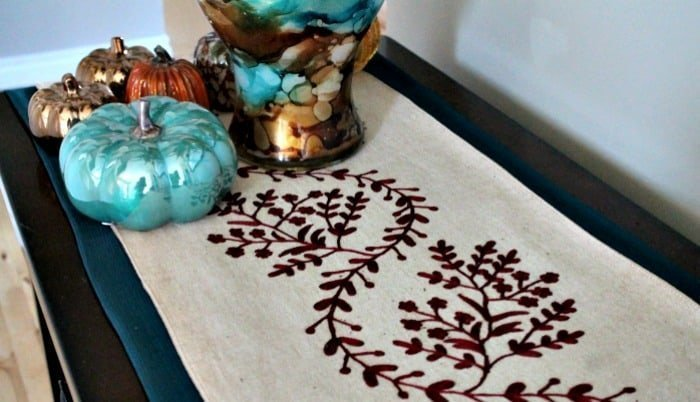A DIY sewn easy to make table runner for easy fall room decor.