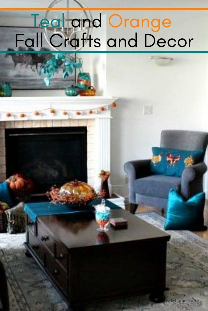 A livingroom decorated for Fall in orange and teal DIY home decor and easy Fall crafts, such as cushions table runners, lights and flower arrangements.