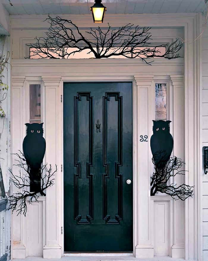 Elegant appearing Halloween front porch with Owls and a black door. DIY Halloween front porch ideas, Halloween porch displays, DIY Halloween yard decorations, DIY Halloween front porch ideas, DIY Halloween front door decorations,