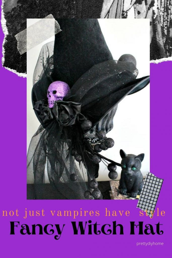 A Fancy black witches hat with sparkling tulle and purple skulls and black roses.