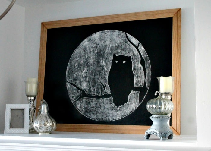 Pretty Halloween chalkboard for classy Halloween decorating ideas. A Halloween mantel that is suitable for older adults, and still fun for Halloween
