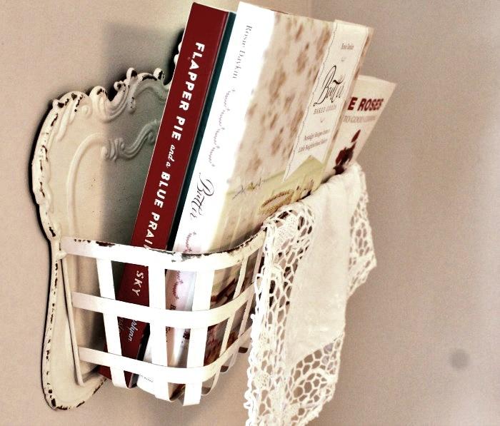 Cookbooks in a pretty metal farmhouse shelf basket. farmhouse kitchen, farmhouse style kitchen, farm style kitchen,farmhouse kitchen accessories