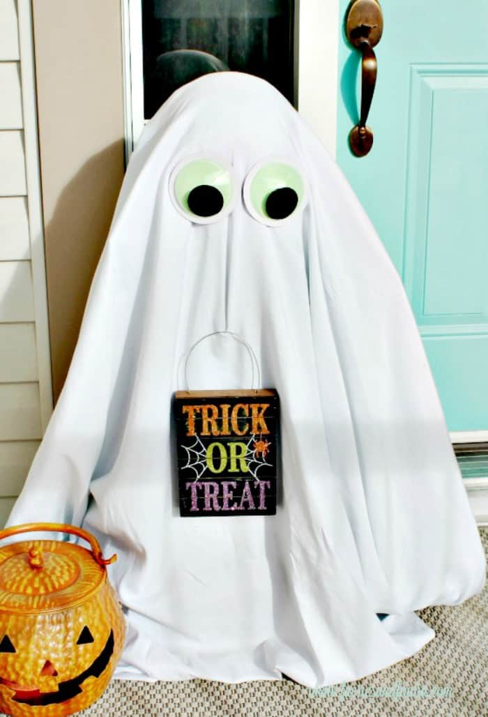 Halloween Front Porch with a DIY Outdoor Halloween Decoration of a cute ghost.