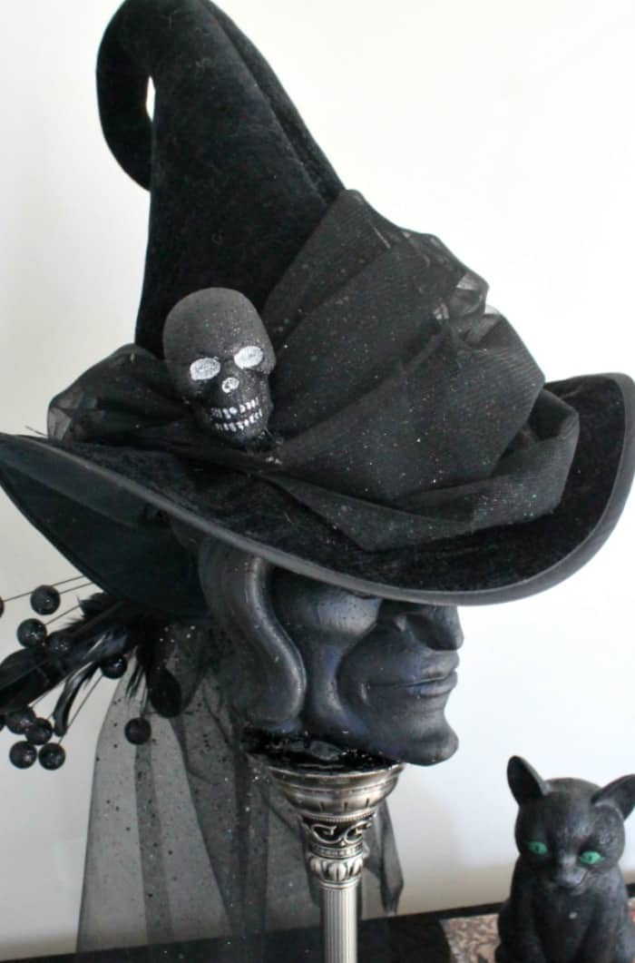DIY witch hat on a thrift store stand, for Halloween. , witch hat decoration ideas, hat witch designs