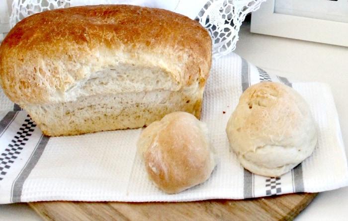 Home made bread on a wood cutting board for farmhouse decor. farmhouse kitchen, farmhouse style kitchen, farm style kitchen,farmhouse kitchen accessories