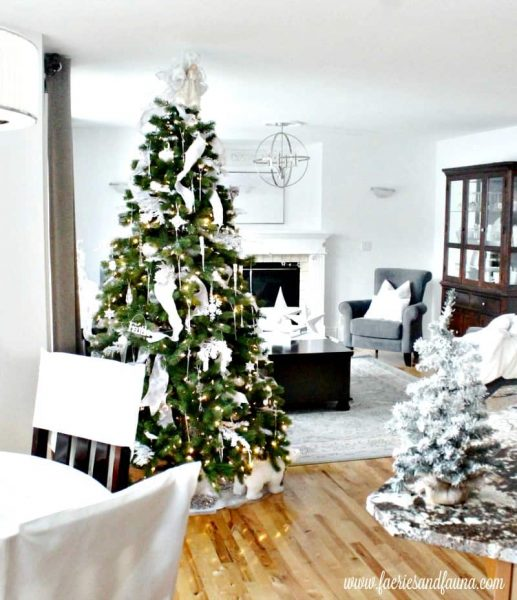 Christmas tree decorated in white decor for the Christmas holidays. Bright and sparkly Christmas decor ideas.