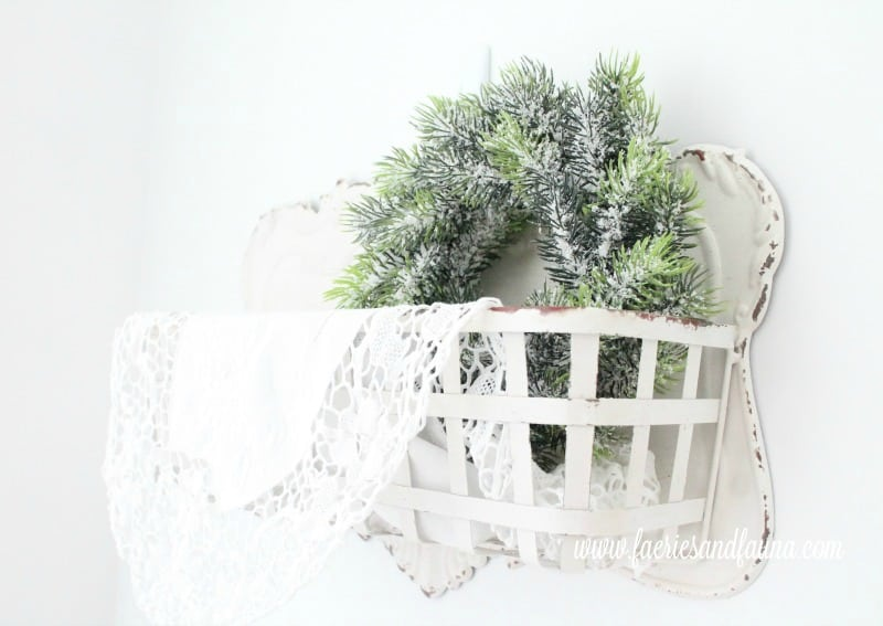Christmas home tour featuring a little farmhouse style wall basket with greenery and white lace. , Christmas House, Christmas Home, Christmas house tour