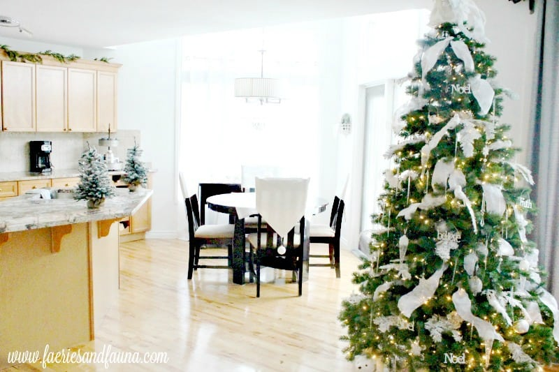 A Christmas home tour featuring all white Christmas decor, done on a budget. An example of how to decorate a home for Christmas on a budget.