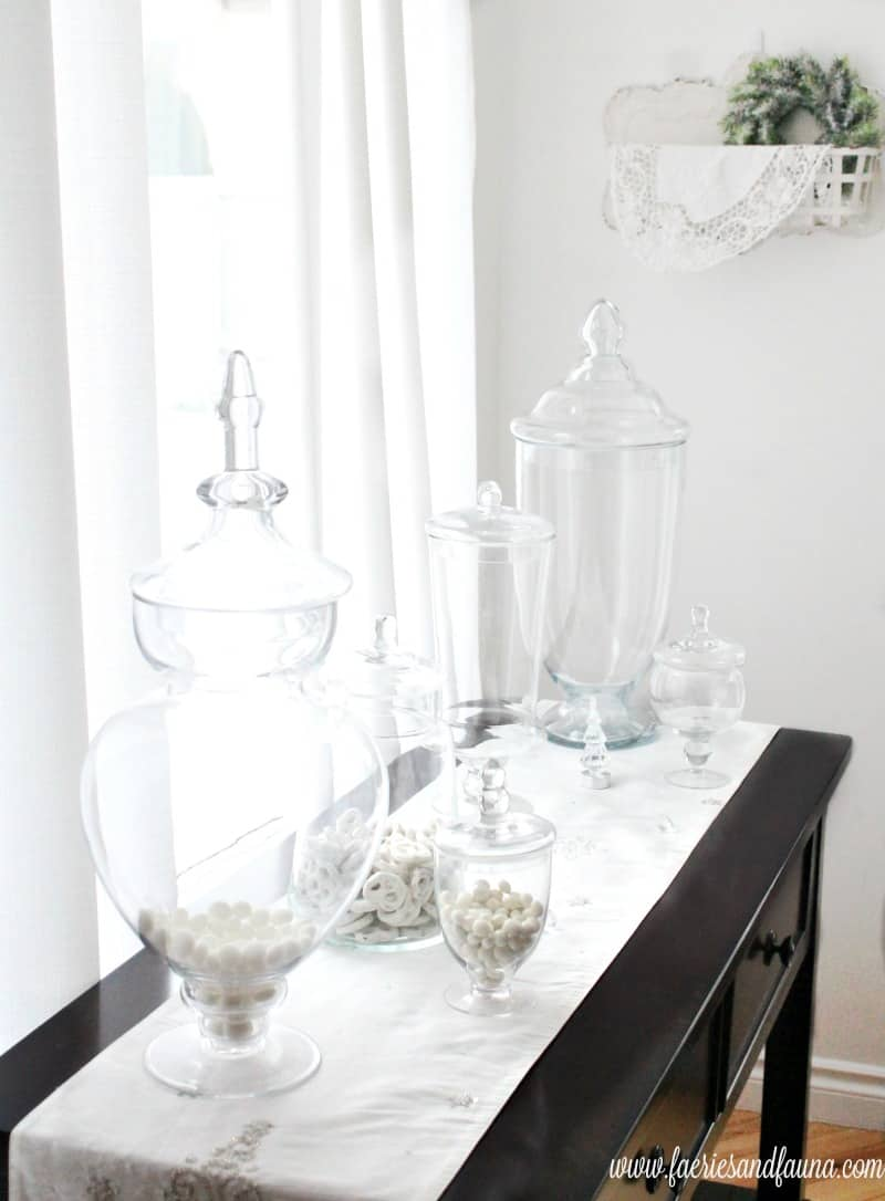A Christmas home tour featuring an array of apothecary jars with all white fllers. Christmas home tour, Christmas House, Christmas Home, Christmas house tour
