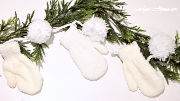 White Christmas Banner with wool pom poms and mittens. Easy DIY Christmas decorations or craft idea.