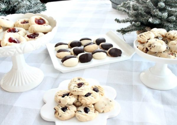 Four types of shortbread Christmas cookies. There are cranberry pistachio shortbread cookies, chocolate coated shortbread, rolo pecan shortbread and jam filled shortbread.shortbread cookies, christmas cookies, christmas shortbread cookies, shortbread cookie recipe,
