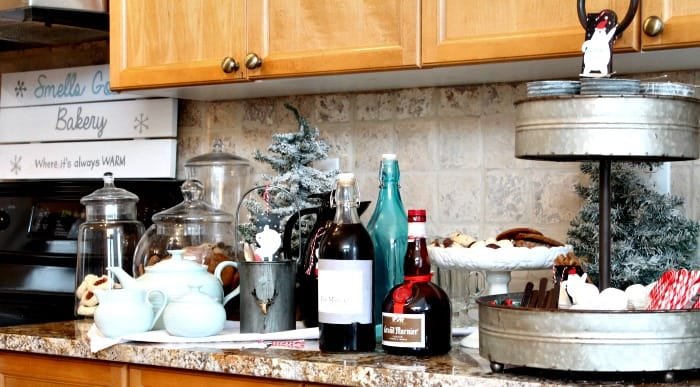 A coffee bar, and cocoa bar arranged on a cupboard with all kinds of fixing and Christmas desserts. hot chocolate bar,hot chocolate bar ideas, hot chocolate toppings,