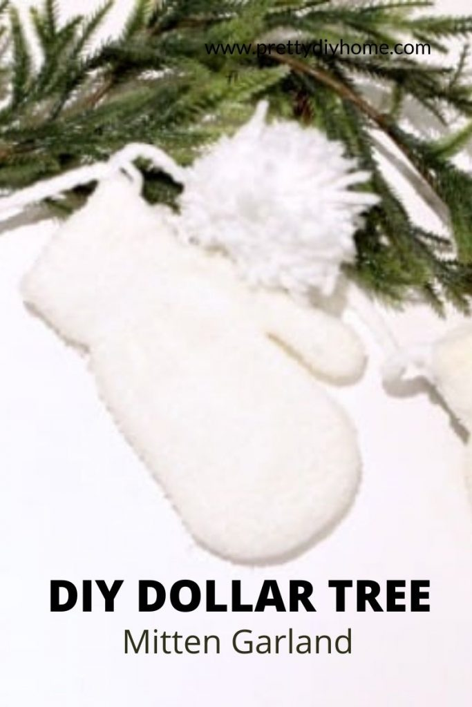 All White DIY Dollar Tree Mitten garland with white pom poms and greenery.