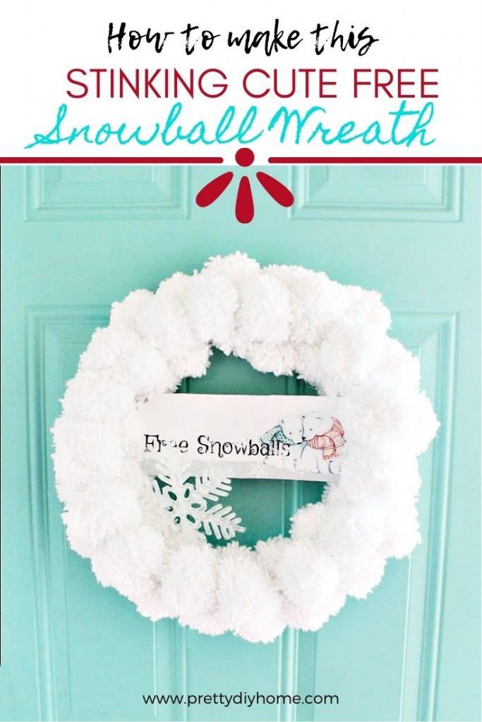 A large pom pom craft made into a pretty snowball Christmas wreath.