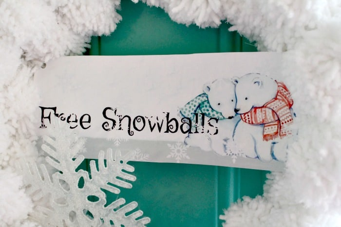 DIY Christmas Wreath made with home made pom poms to look like snowballs and become a Snowball wreath with a Free Snowball printable banner with polar bears. Snowball Wreath