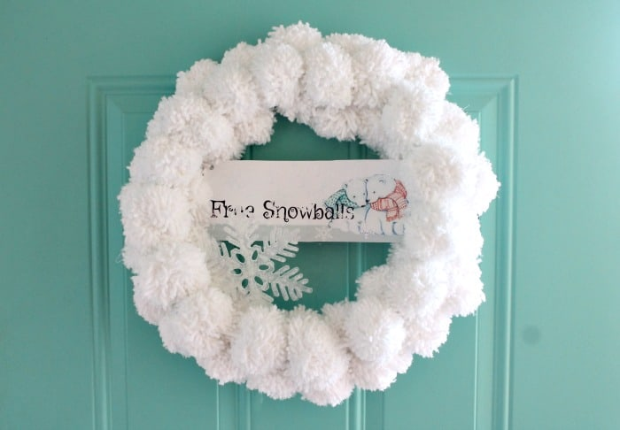 A homemade snowman DIY Christmas Wreath, A snowball themed Christmas wreath for the front door.