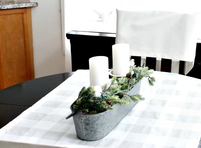 Easy DIY Christmas Centerpieces, this simple centerpiece has a farmhouse style, and based on natural greenery.