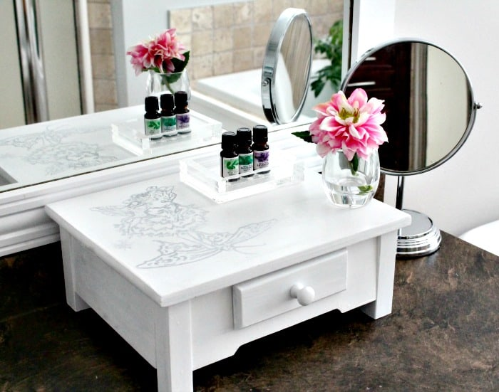 A DIY furniture upcycle from old plant stand to new DIY table riser idea for the bathroom, little girl's bedroom, or vanity.