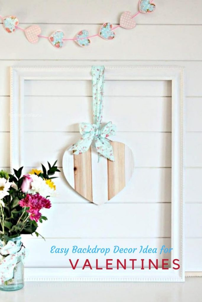 A DIY Valentine decoration made using a wood heart, paint and farmhouse frame.