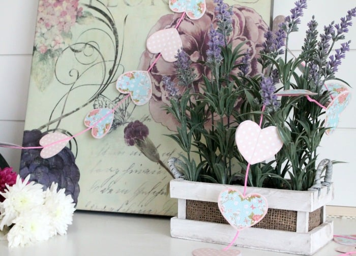 A valentine craft idea, a diy valentine banner free printables of hearts in soft blues and pink polka dots