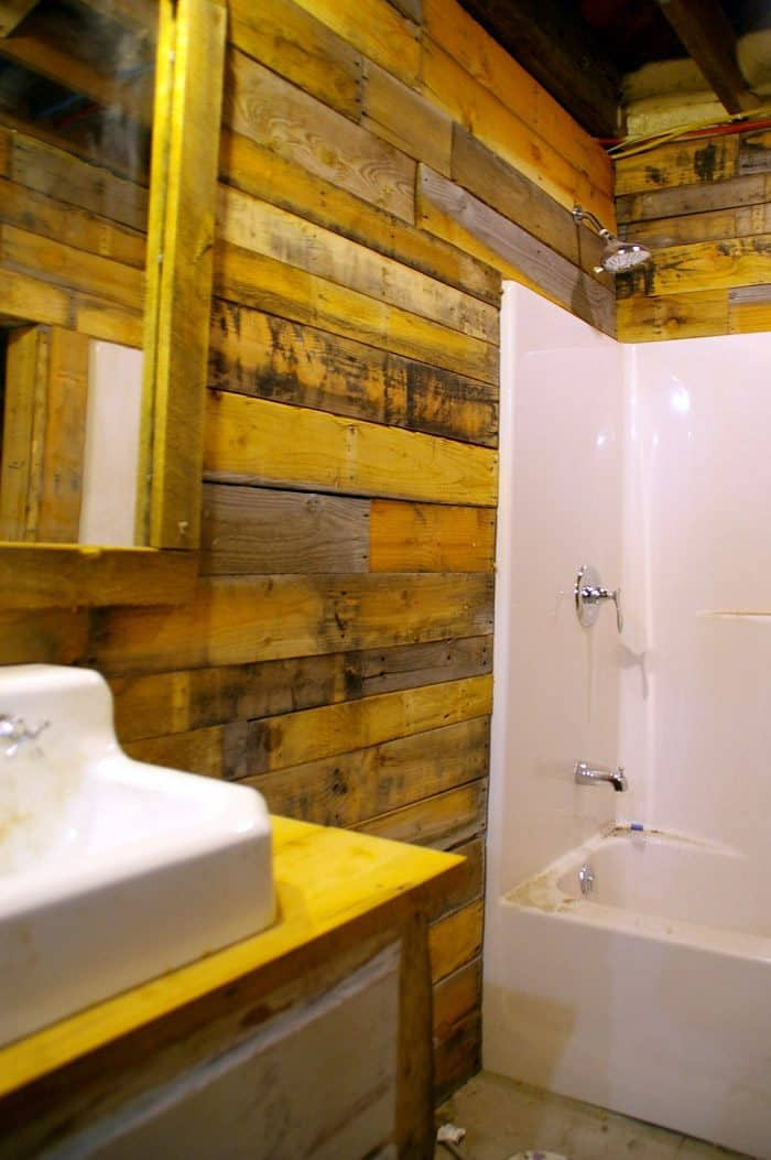 """My main experience using shiplap was in my basement. (Unfortunately, it was not ALL shiplap as there was only so much leftover in my """"barn stash"""" so I ended up with a combination of pallet wood, shiplap and barn wood all mixed in.) I liked the rustic look as my basement is """"what it is"""" however there was a part of me that was really itching to paint it white 😉 In true Chip and JoJo fashion lol I still may end up going down there someday and painting it out (at least just in the bathroom) just to make the whole place a little cleaner and lighter feeling."""
