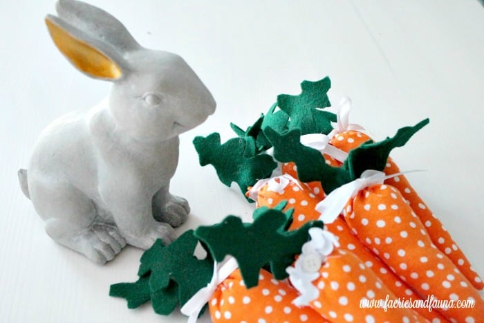 Easter craft idea, handmade fabric miniature carrots with felt leaves and polka dota.