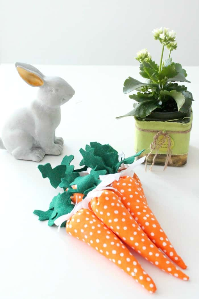 Easy Easter craft, handmade stuffed miniature carrots with polka dots and felt leaves.