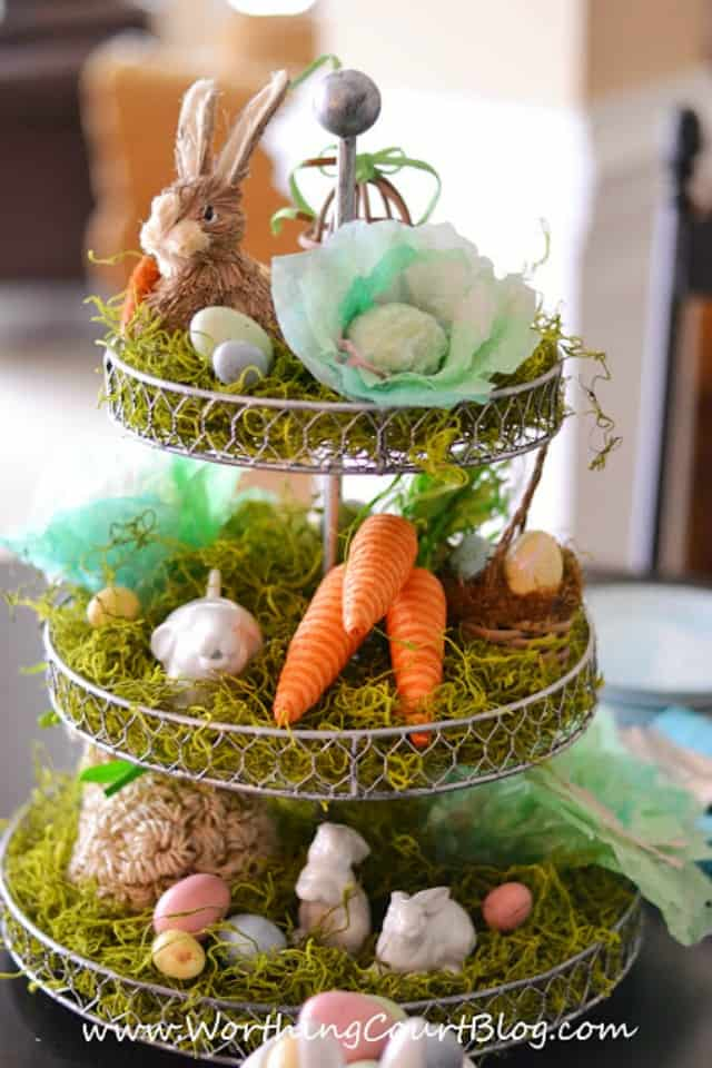 An Easter themed Spring themed tiered tray for decorating.  This one has rabbits, moss, carrots and Easter eggs