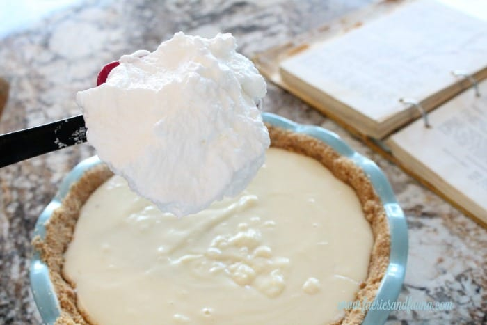 Fluffy white meringue being placed onto the filling of a flapper pie. flapper pie, flapper pie recipe, vintage pie recipe, vintage recipes,