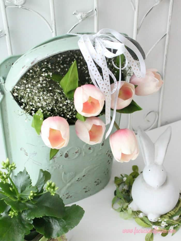 A spring flower arrangement with tulips,  It can use indoors for Spring decor or outside for a wreath.