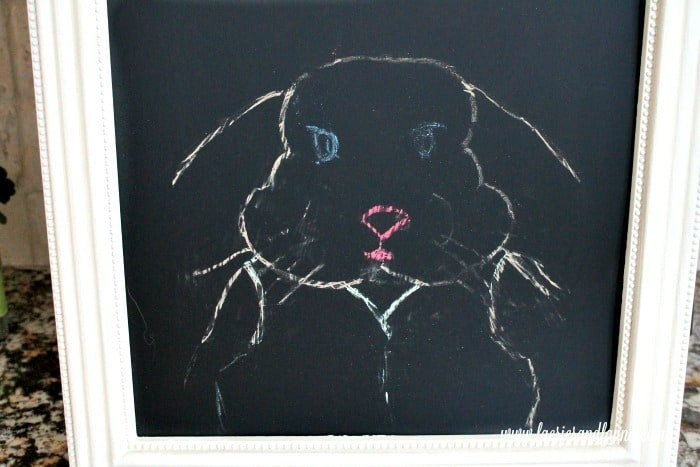 An chalkboard craft for Easter. How to transfer chalk onto a chalkboard from a template for making an Easter bunny chalkboard.