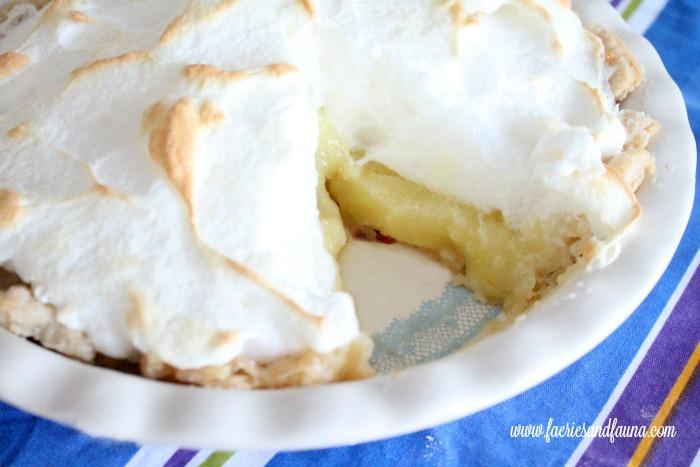 Lemon Meringue pie with a cut serving.