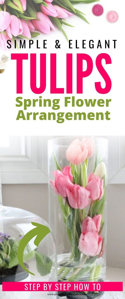 A tall vase filled with fresh pink tulips. The tulips are arranged so that they are inside the interior of the vase.