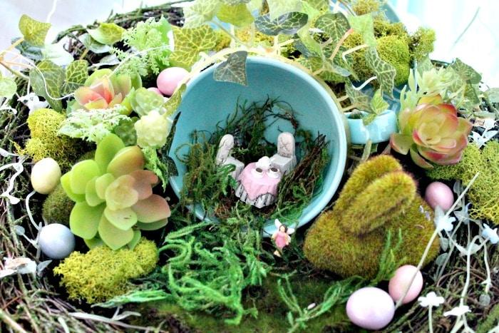 A DIY teacup fairy garden with faux moss. A pretty Easter centerpiece, indoor fairy garden or Easter arrangement.