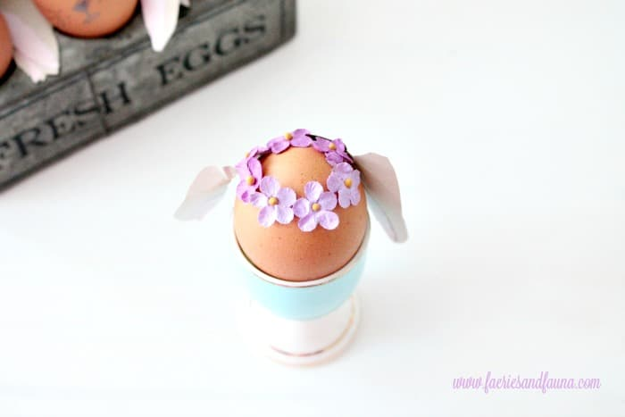 Tiny flower crown being added to the top of a Bunny Easter eggs. How to decorate Easter eggs.