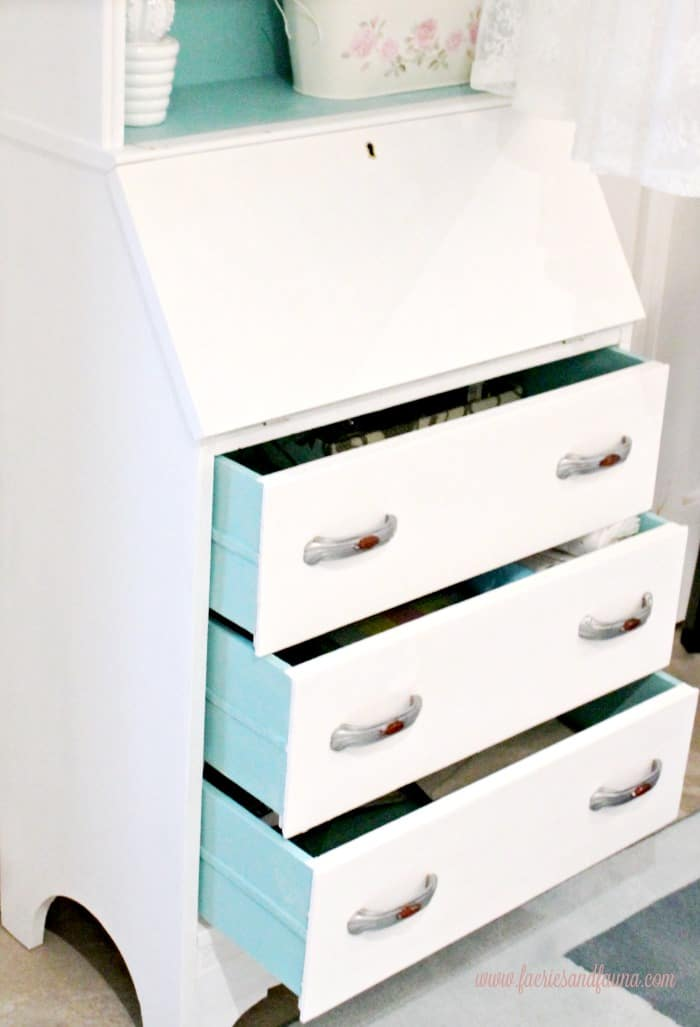 A painted secretary in white and turquoise. The drawers have received a veneer repair.