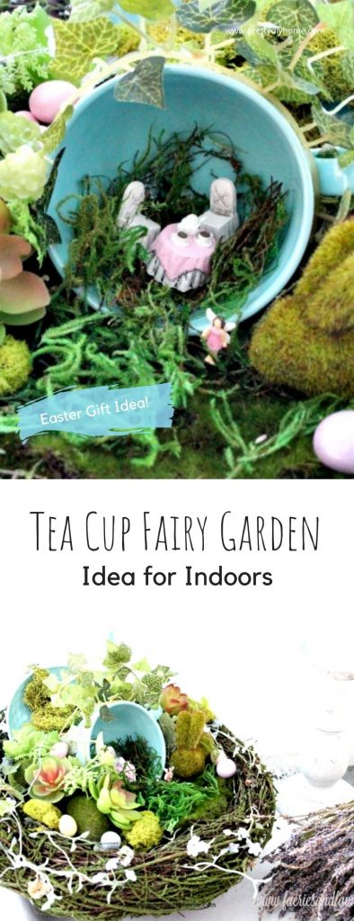 A tea cup fairy garden idea for indoors with a blue tea cup with miniature table setting and surrounded by moss, plants and an nest.