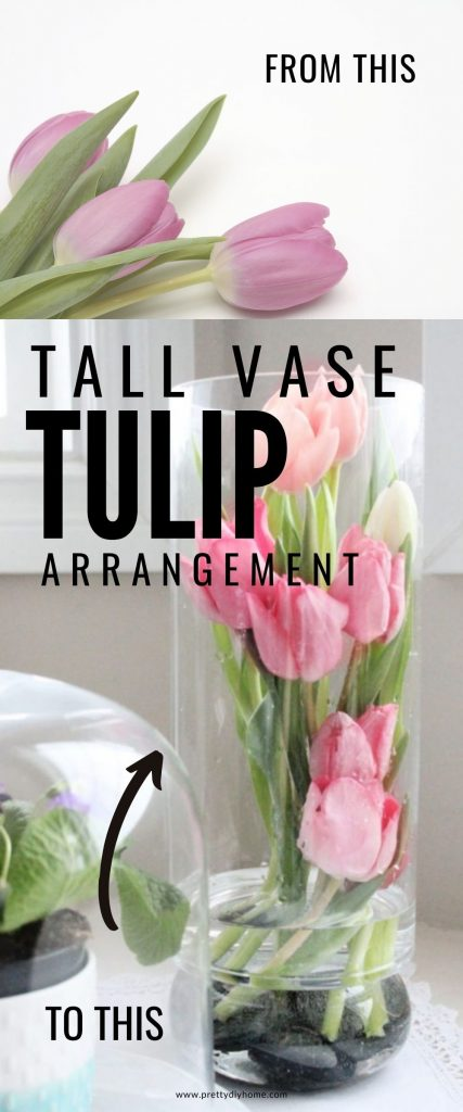 A tall vase tulip arrangment, the vase has the tulips inside the glass and they are pink. There are six pretty pink tulips.