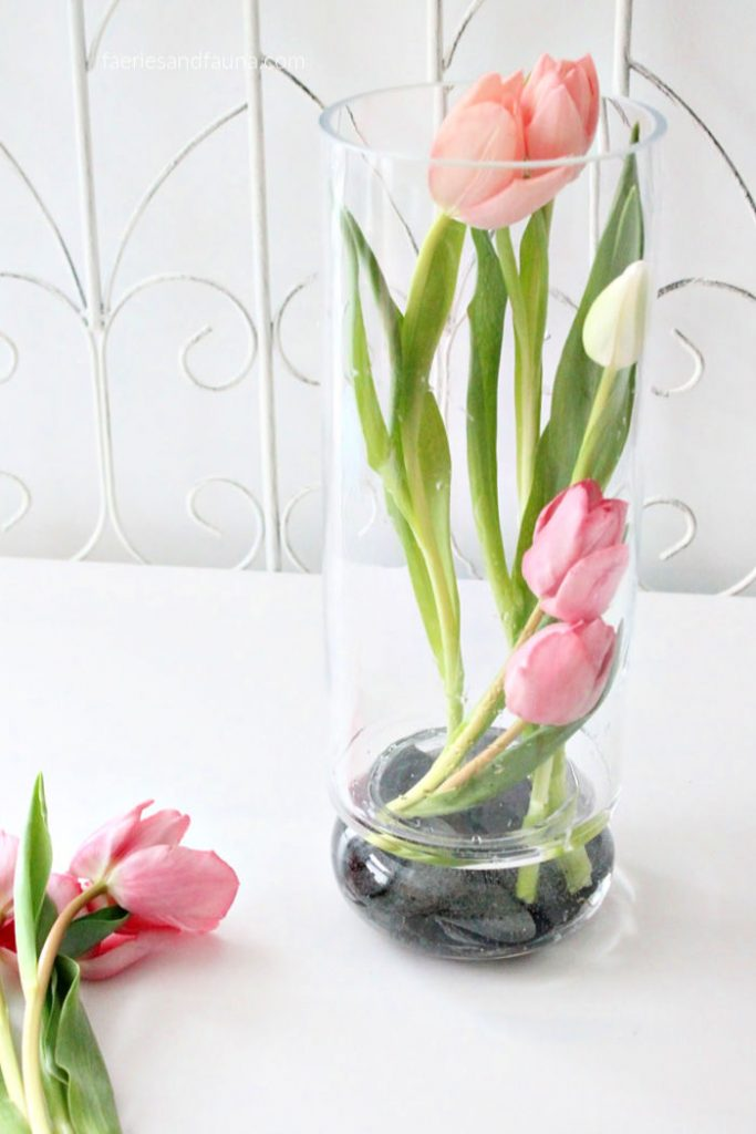A DIY tulip arrangement in a tall vase. How to make a simple and modern tulip arrangement.