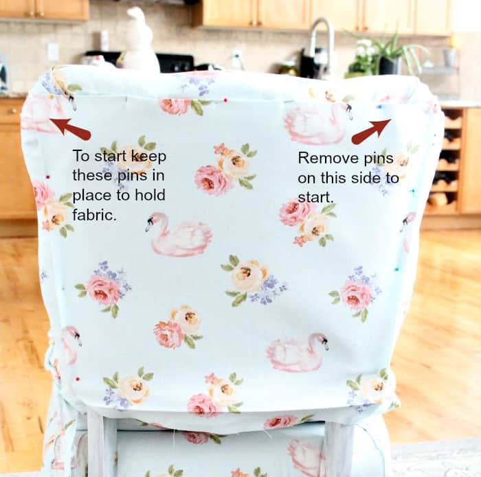 The back of a thrift store chair makeover with pinned on new fabric. Chair repair, furniture restoration, recover chairs DIY, how to reupholster a chair, reupholstery, chair reupholstery, furniture repair, recovering furniture, how to recover a chair.