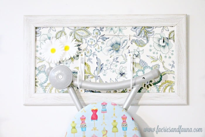 A mini clothesline on a DIY ironing board hanger.