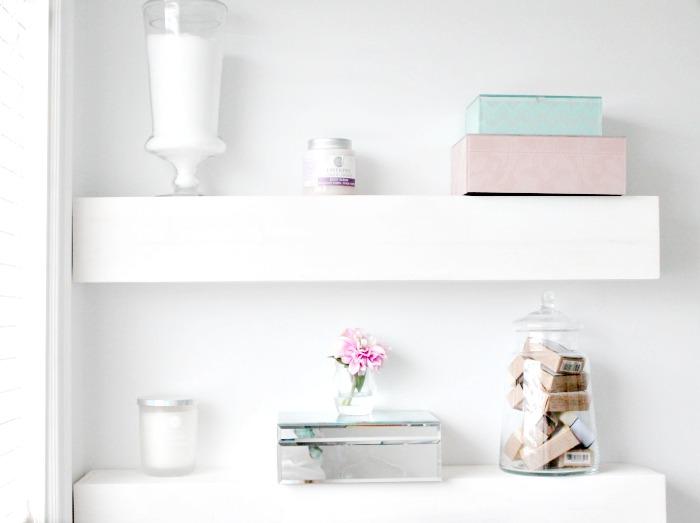 White DIY floating shelf for the bathroom for organization ideas.