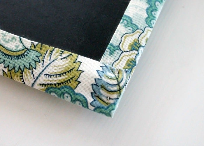 Pinning a corner neatly on a fabric covered DIY ironing board hanger.