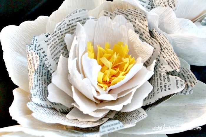 Closeup photo showing all the various layers of hand made paper petals formed together to make a beautiful crepe paper peony. Flower making, how to make paper flowers, flower making with crepe paper, minimalist wreath, elegant wreath, diy wedding decor, paper flowers wedding, book page crafts.