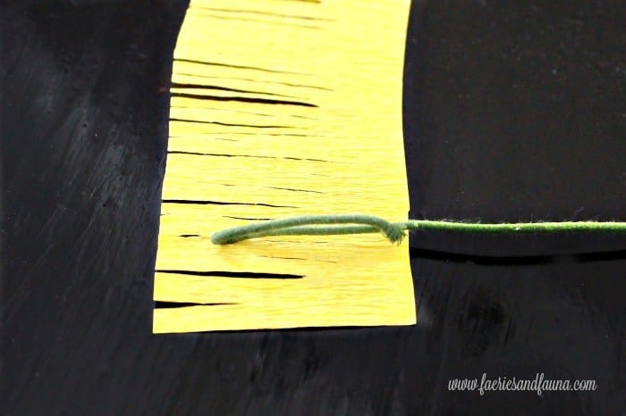 Wrapping crepe paper around wire for the center of a peony flower. Beautiful paper craft idea how to make crepe paper flowers